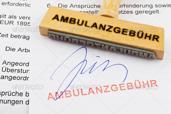 wood stamp on the document: ambulance fee - Stock Photo - Images