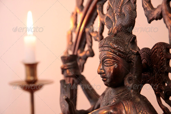 Statue of the goddess Shiva with candle - Stock Photo - Images