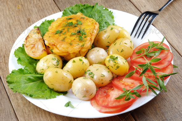 Fried fish with potatoes - Stock Photo - Images