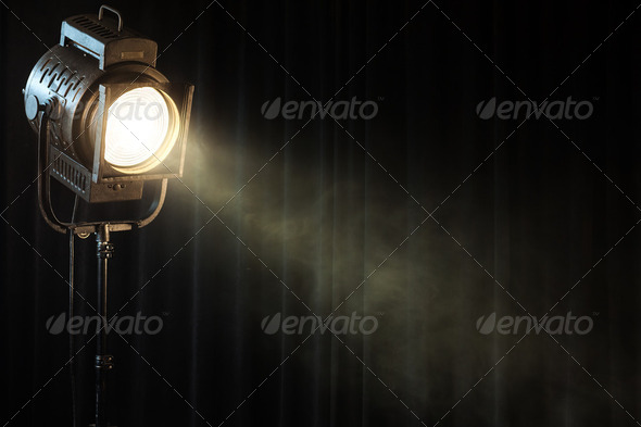 PhotoDune vintage theatre spot light on black curtain with smoke 2350369