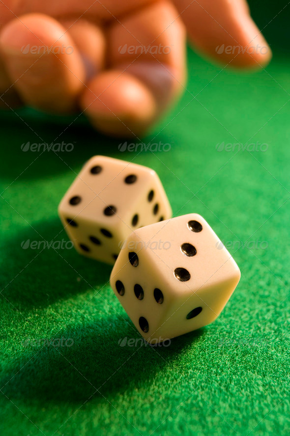 rolling dice - Stock Photo - Images