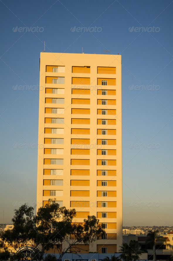 Apartment building lit by sunrise - Stock Photo - Images