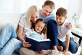 Family with book