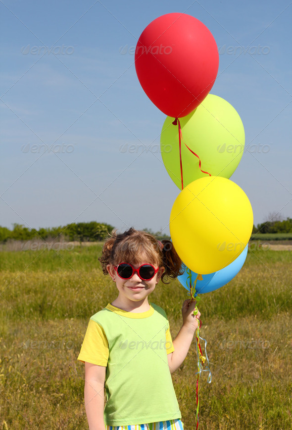 Little girl with colorful balloons posing - Stock Photo - Images