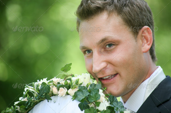Groom with bouquet - Stock Photo - Images