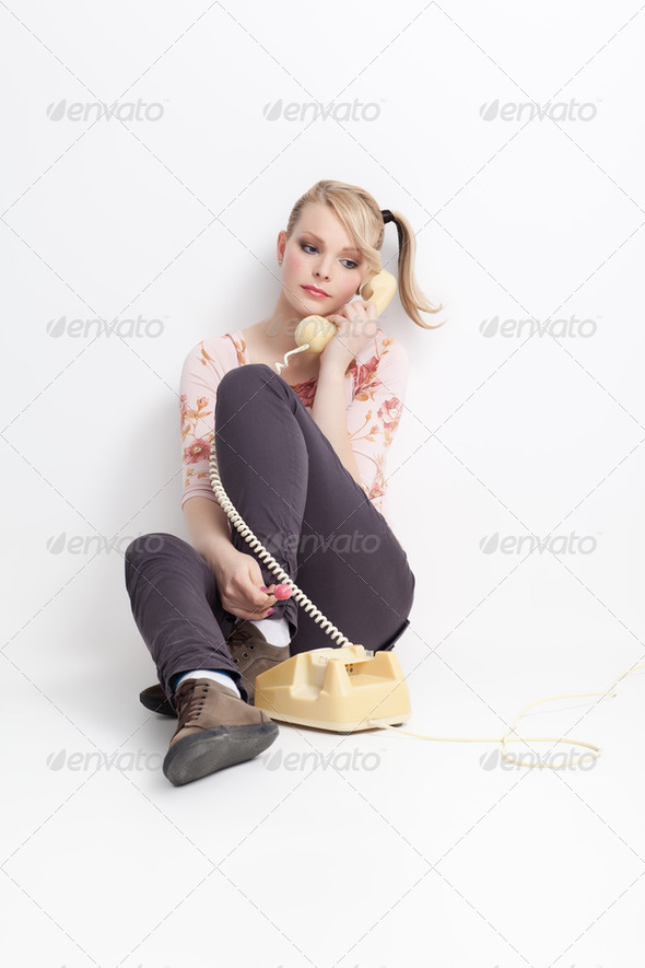 young woman talking on telephone - Stock Photo - Images
