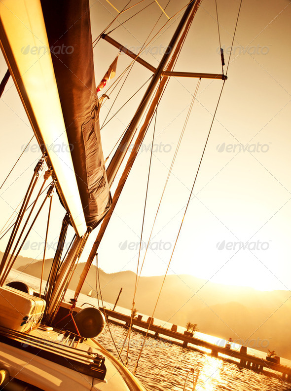 Sailboat on sunset - Stock Photo - Images