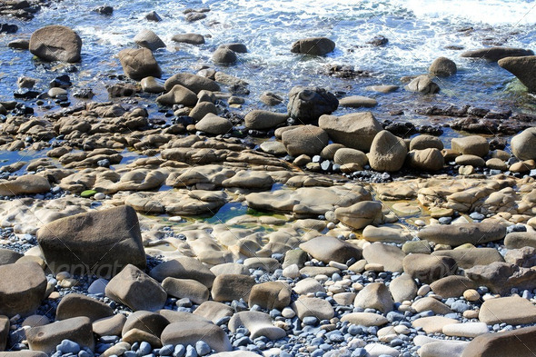Rocks and Pebbles on the British Cornish Coast - Stock Photo - Images
