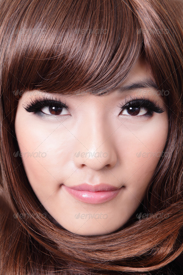 closeup portrait of beautiful young woman with brown hairstyle - Stock Photo - Images