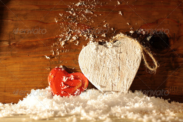 Wooden hearts in snow - Stock Photo - Images