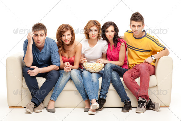 young group of friends watching questioning movie - Stock Photo - Images