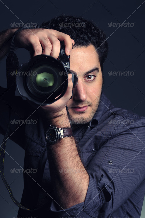 Young photographer taking pictures with digital camera - Stock Photo - Images