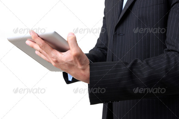 Businessman working on digital tablet - Stock Photo - Images