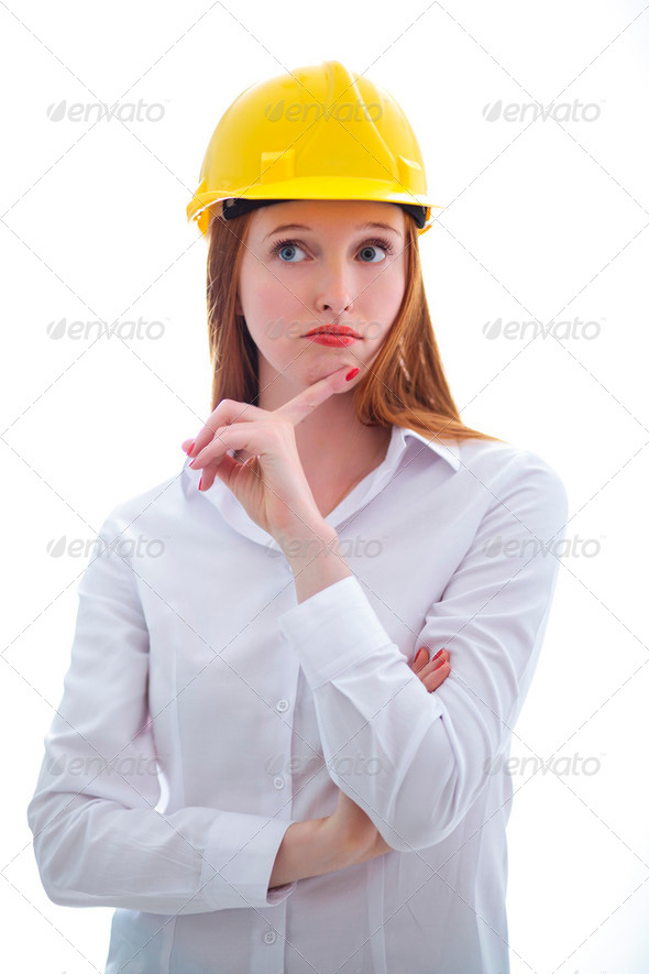 Long haired happy girl with yellow helmet thinking - Stock Photo - Images