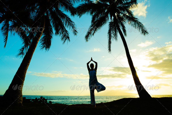 Woman Doing Yoga at Sunset - Stock Photo - Images