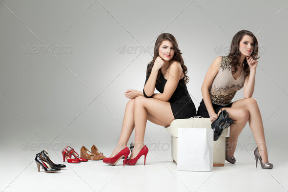 two glamorous women trying high heels - Stock Photo - Images