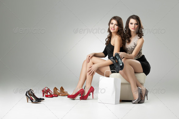 two women trying high heels - Stock Photo - Images