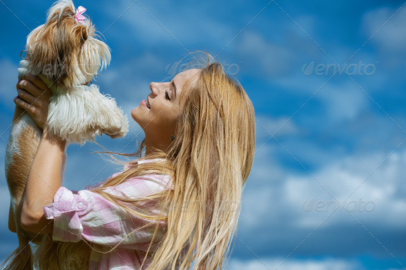 beautiful smiling young woman with small dog - Stock Photo - Images