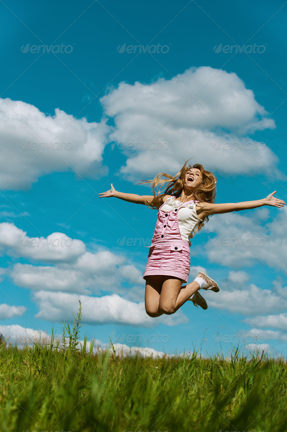 young woman close-up jumping - Stock Photo - Images