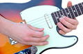 Closeup on hands playing guitar isolated on white - PhotoDune Item for Sale