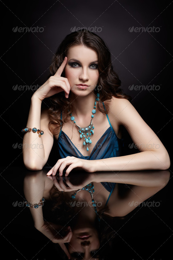 brunette woman and mirror - Stock Photo - Images