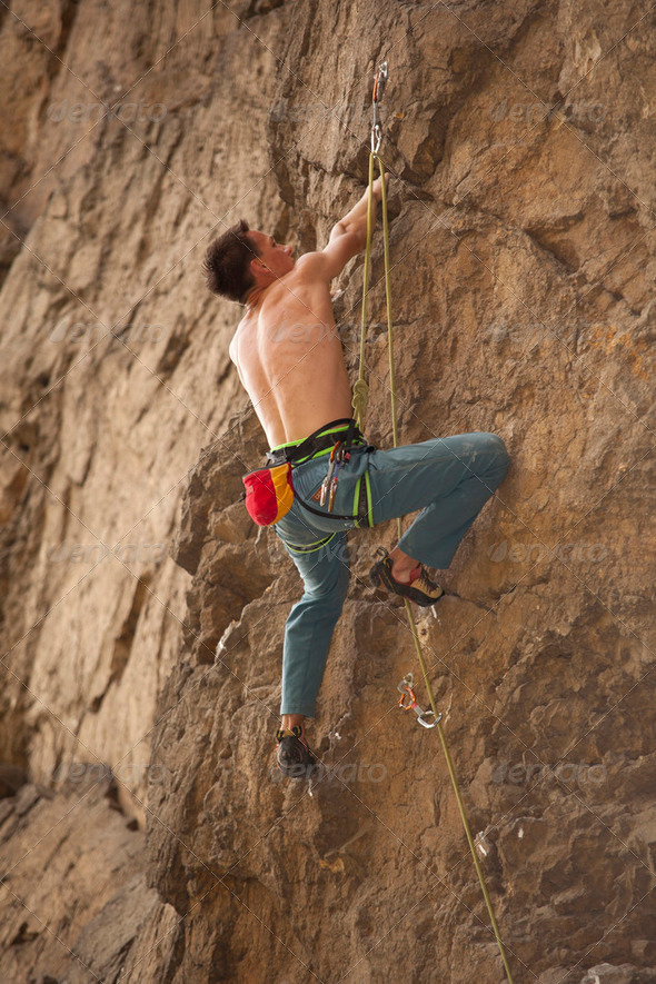 Young man climbs - Stock Photo - Images