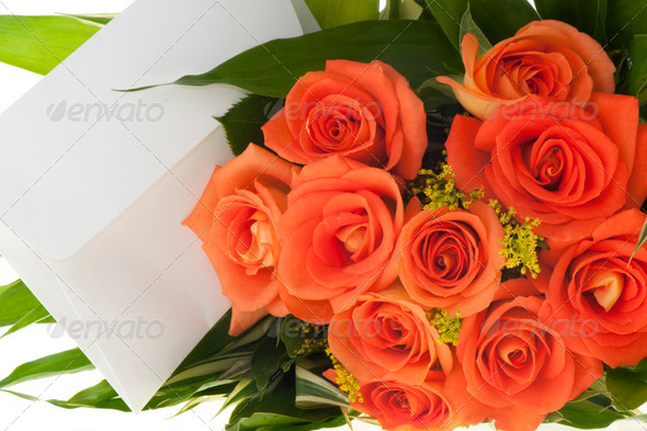 Bouquet of orange roses and ticket - Stock Photo - Images