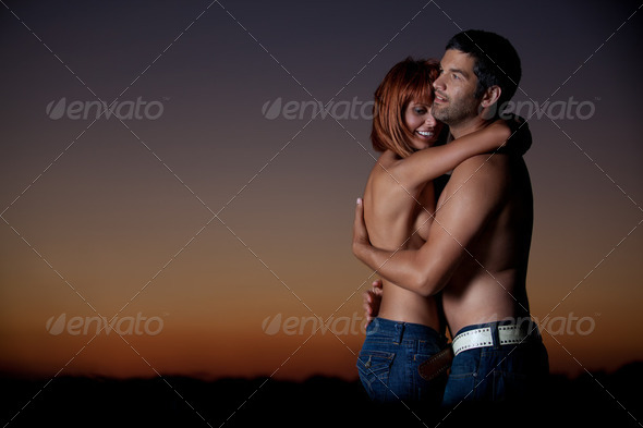 young couple having fun on the beach - Stock Photo - Images