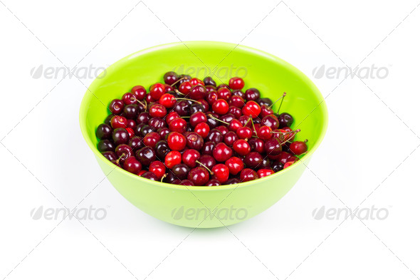 Cherry in green plastic bowl isolated on white background - Stock Photo - Images