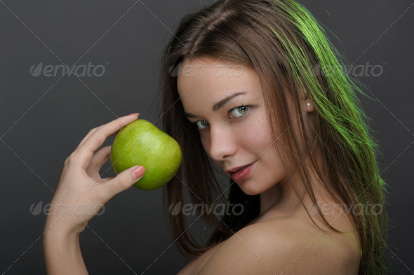 Woman with apple - Stock Photo - Images