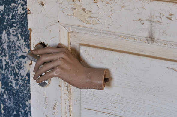 mannequin doll hand old door - Stock Photo - Images