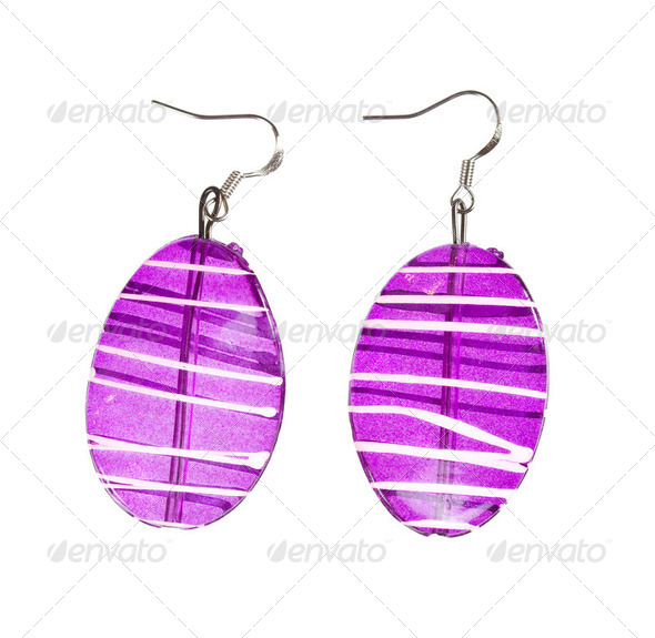 Earrings in purple glass on a white background - Stock Photo - Images