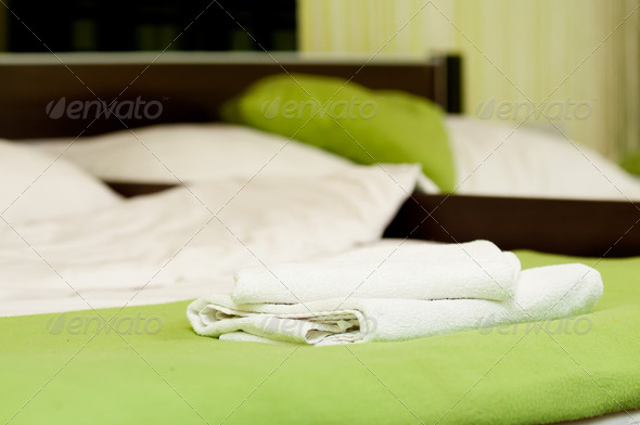white towel on the hotel bed - Stock Photo - Images