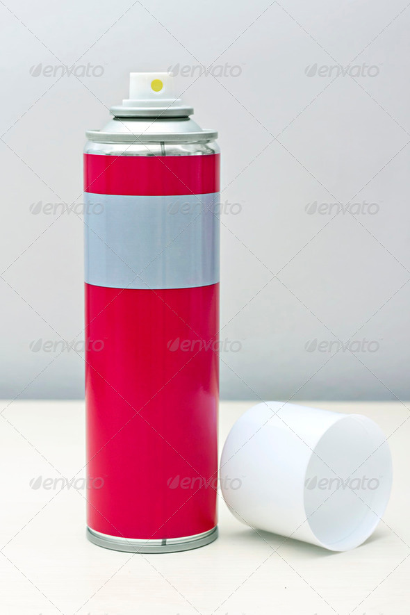 reddish gray with a white spray can lid - Stock Photo - Images