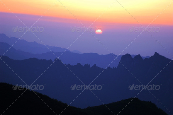 Landscape of sunrise on the top of mountains - Stock Photo - Images