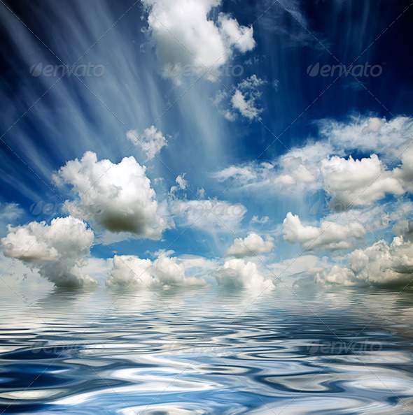 stormy sky reflected in water waves - Stock Photo - Images