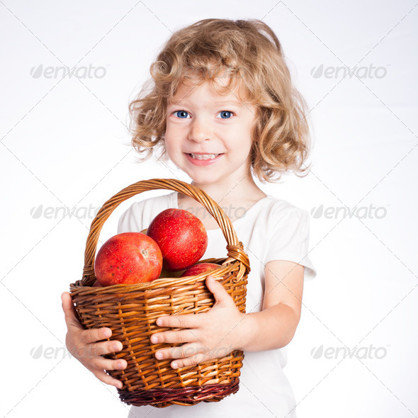 Child with basket of apples - Stock Photo - Images