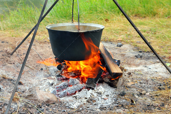 kettle over campfire - Stock Photo - Images