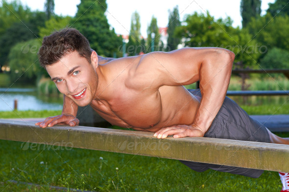 Good looking guy making push ups - Stock Photo - Images