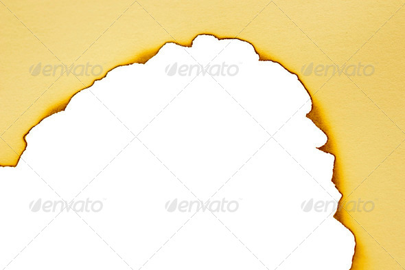 Sheet of paper with the scorched edges - Stock Photo - Images