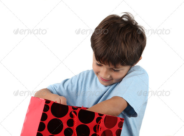 Young happy boy with gift bag - Stock Photo - Images