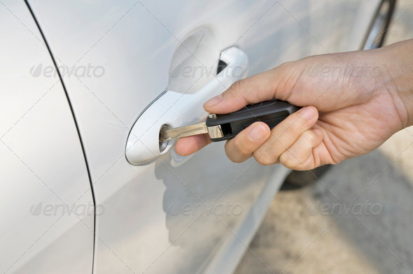 Inserting Car Key - Stock Photo - Images