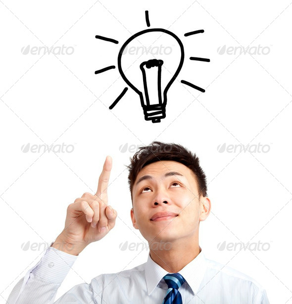 young businessman pointing bulb and idea concept - Stock Photo - Images