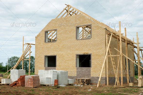 Brick house under construction - Stock Photo - Images