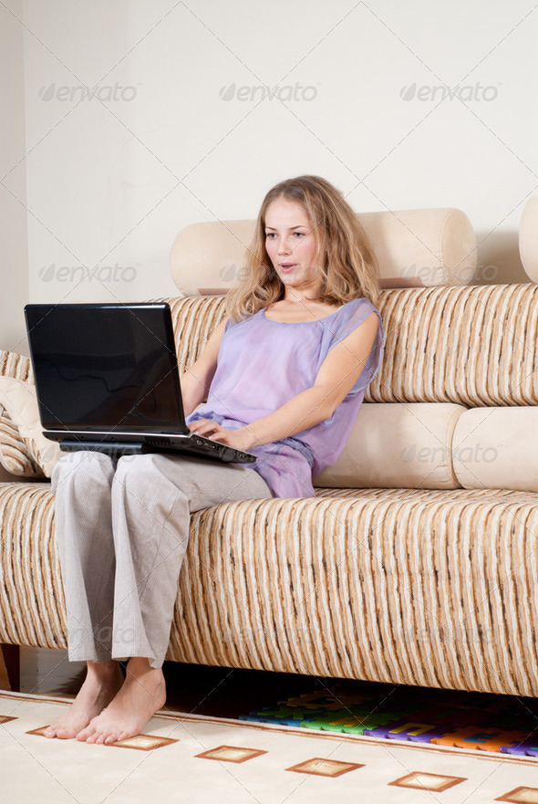 Excited woman with laptop - Stock Photo - Images