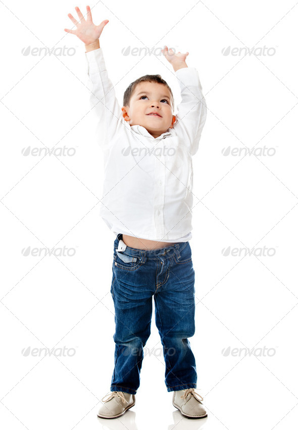 Boy reaching ceiling - Stock Photo - Images