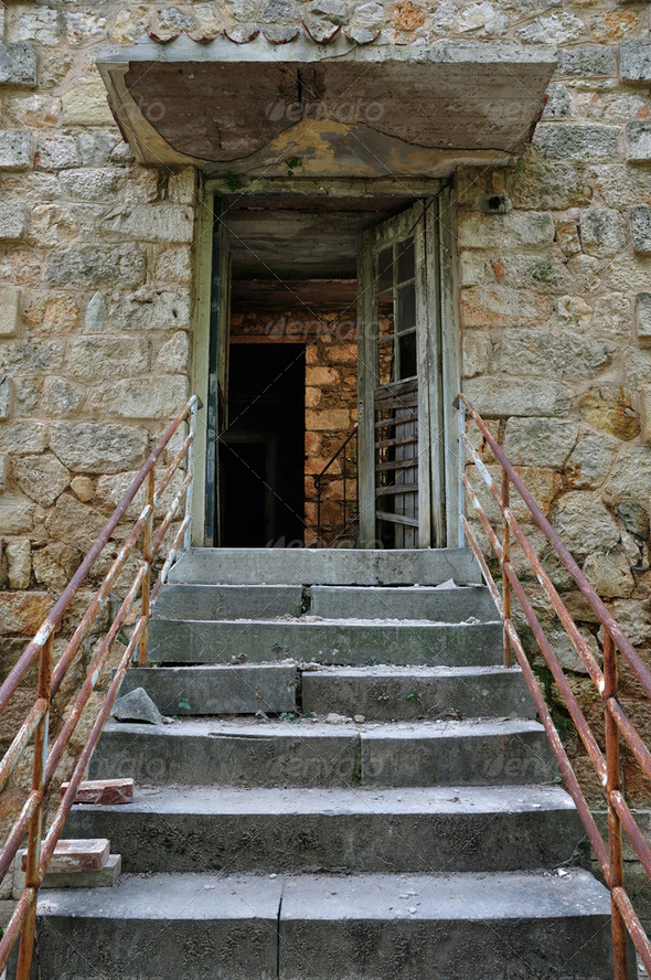 crumbling staircase broken door - Stock Photo - Images