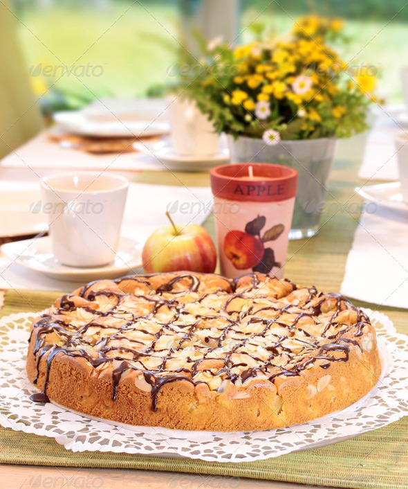 Apple cake on tea table - Stock Photo - Images