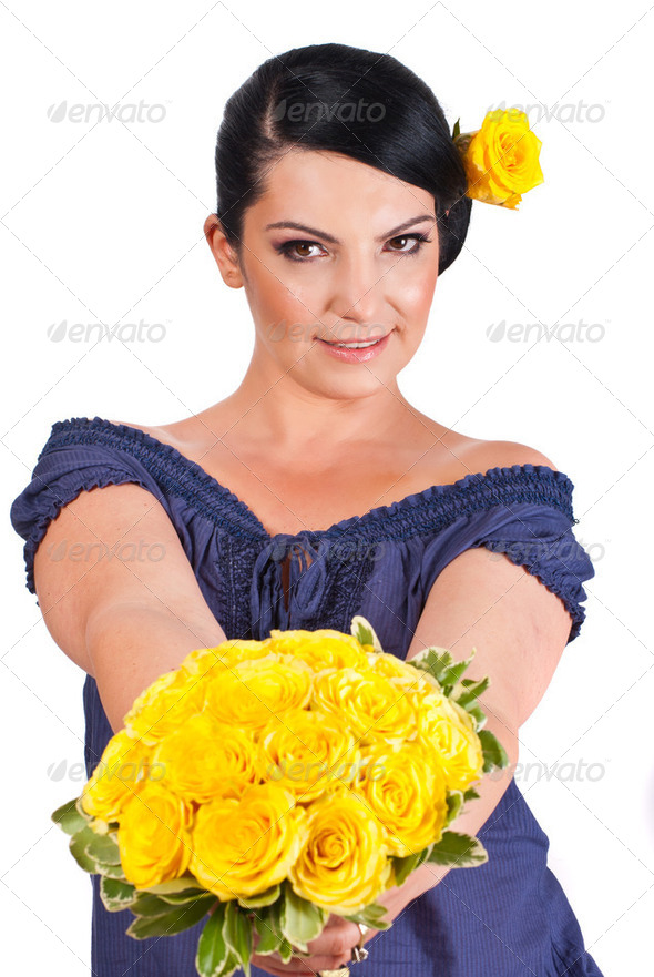 Attractive woman offering yellow roses - Stock Photo - Images