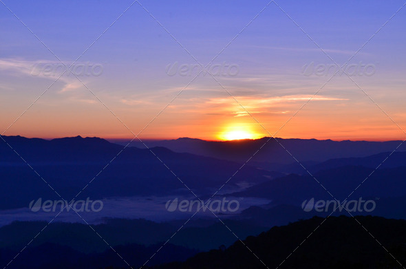 Sunrise in the deep mountains landscape - Stock Photo - Images